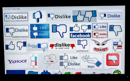 Bangkok, Thailand - March 29, 2014: A logotype collection of Facebook Like and dislike well-known world brand's on the computer screen. Facebook is the most popular social networkins site in the world.
