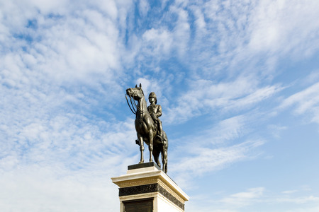 The equestrian statue of King Chulalongkorn (Rama V) with blue sky background in Bangkok, Thailand.