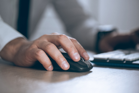 Foto de Hand on mouse. Businessman computer. Business success, contract and important document, paperwork or lawyer concept. Man in office - Imagen libre de derechos