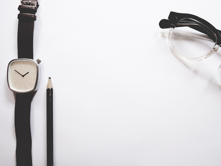 This is office equipment in minimal style, The picture of pen, glasses and watch on white background. soft tone color,  minimal style