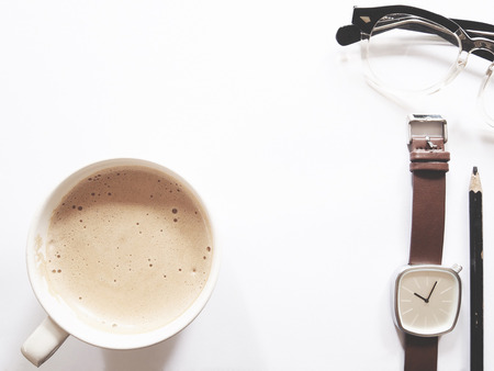 This is office equipment and hot coffee in minimal style, The picture of pencil, glasses, watch and hot coffee on white background. soft tone color,  minimal style