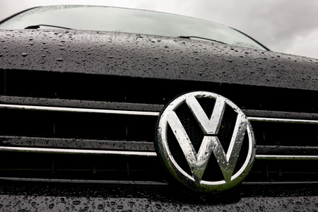 Photo for KINSARVIK, NORWAY - AUGUST 13, 2016: Logo of the Volkswagen automotive company on a black Transporter van during the raining weather with water drops - Royalty Free Image