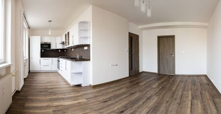 Photo pour Brand new white kitchen with coffee oak floor and empty living room after complete reconstruction of the whole flat ready for moving new family - image libre de droit
