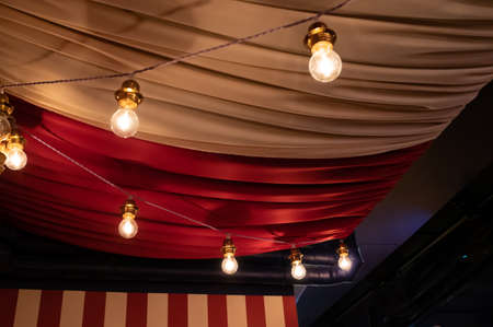 Photo pour Ceiling decorated with heavy fabrics and light bulbs to show a circus feeling - image libre de droit