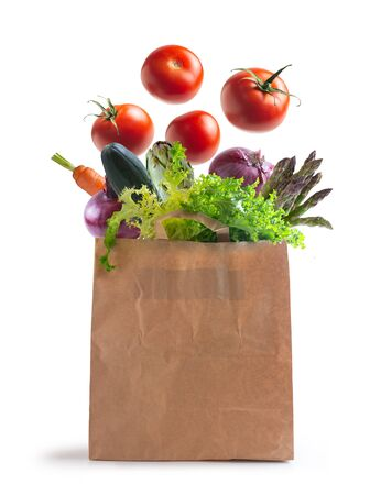 Photo pour ecological bag of vegetables isolated from the background. flying vegetables - image libre de droit