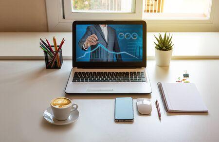 Photo pour Work table at home, laptop with finance web - image libre de droit