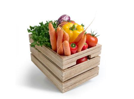 Foto de Fresh vegetables in a wooden box isolated from white background - Imagen libre de derechos