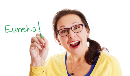Woman with glasses having a Eureka big and bright idea moment!