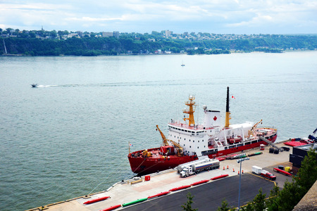 CANADA, QUEBEC CITY- JULY 20, 2014: Canadian coast guard Des Groseillers vessel  on the St.Lawrence, docked in Quebec city. The Coast guard is responsible for 2.3 million square nautical miles (8 million km2).