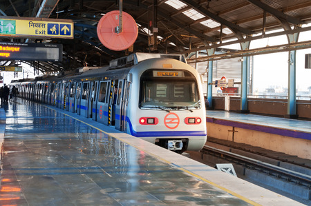 NEW DELHI, INDIA, DEC - 5, 2014: Delhi Metro station. Delhi Metro is the network consists of five colour-coded lines (Red, Blue, Green, Yellow, Violet), plus a sixth Airport Express line, with a total length of 193 kilometres
