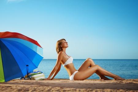 Image of luxury girl lies on the beach