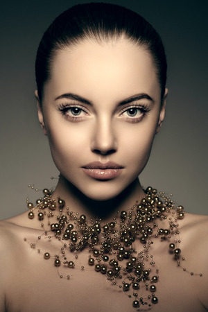 Photo for High-fashion Model Girl. Beauty Woman high fashion Vogue Style Portrait of beautiful fashionable girl Luxury lady with precious jewelery of pearls around her neck, necklace  Stylish Makeup,  Make up Perfect skin, eyes and lips - Royalty Free Image