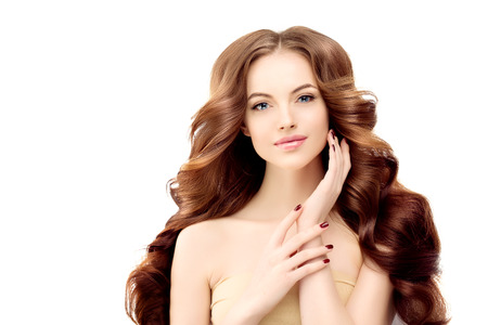 Woman Model with long wavy hair.