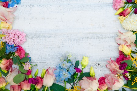 Photo for Spring flowers on wood background. Summer blooming border on a wooden table. - Royalty Free Image