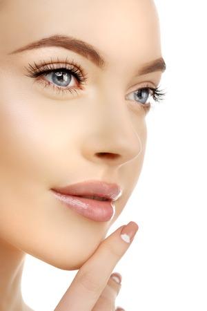 Foto de Young Beauty Woman with Clean Fresh Glowing Skin. Beautiful girl. Cosmetology and Facial Treatment, spa. - Imagen libre de derechos
