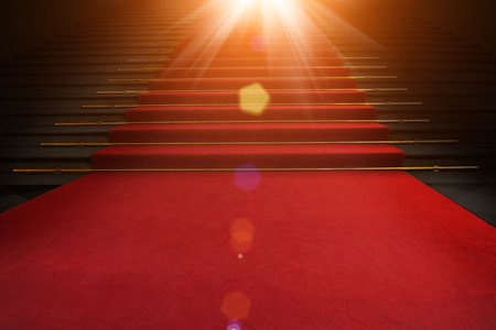 Foto per Red carpet on the stairs on a dark background. The path to glory, victory and success - Immagine Royalty Free
