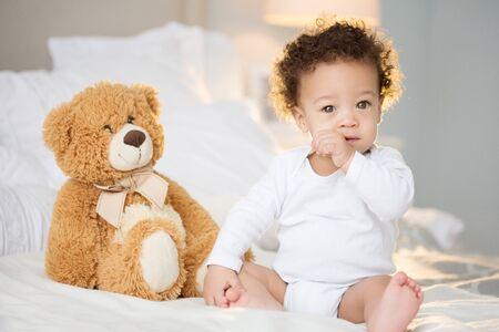 Foto de Cute baby with fluffy hair. Pretty boy. - Imagen libre de derechos