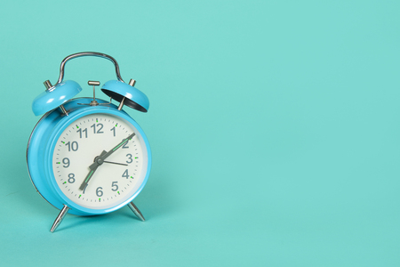 Foto de Blue retro clock on a blue background with copy space - Imagen libre de derechos