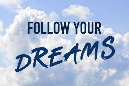Photo pour Phrase follow your dreams on a blue clouded sky - image libre de droit