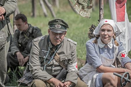 TEKOV, SLOVAKIA - JULY 26,2014: German lieutenant and a nurse on a