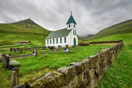Small village church with cemetery in Gjogv located on the northeast tip of the island of Eysturoy, Faroe Islands, Denmark