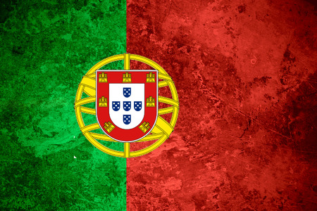 flag of Portugal or Portuguese banner on vintage metal texture