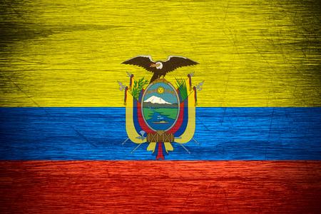 Ecuador flag or banner on wooden texture