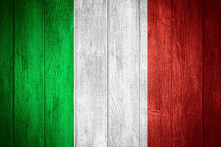 Foto de Italy flag or Italian banner on wooden boards background - Imagen libre de derechos