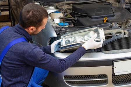 Photo pour mechanic men with wrench repairing car engine at workshop - auto service, repair, maintenance and people concept. - image libre de droit