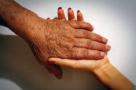 The process of aging of human skin - wrinkled hands of a very old man who lived 90-100 years with dry skin covered with wrinkles and spots