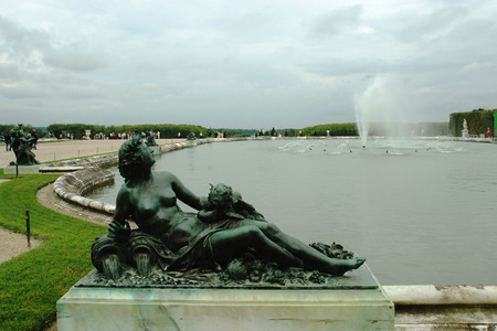 VERSAILLES, FRANCE, AUGUST 19, 2006 - One of the sculpture at the fountain in the castle gardens of Versailles