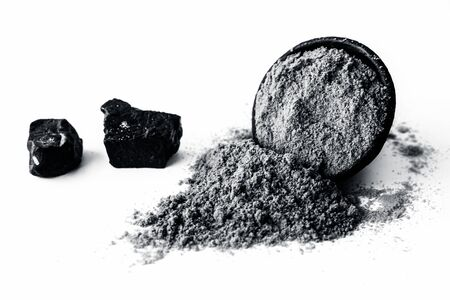 Raw hing or asofoetida or devil's dung isolated on white with its power also.