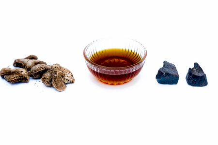Remedy to cure respiratory problems isolated on white i.e. Suth or dried ginger well mixed with hing or devil's dung and honey.