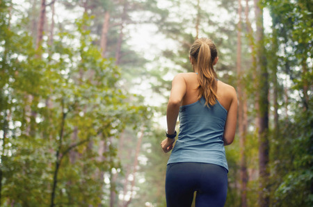 healthy lifestyle fitness sporty woman running early in the morning in forest area, fitness healthy lifestyle concept