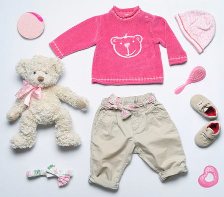 top view fashion trendy look of baby girl clothes and toy stuff, baby fashion concept