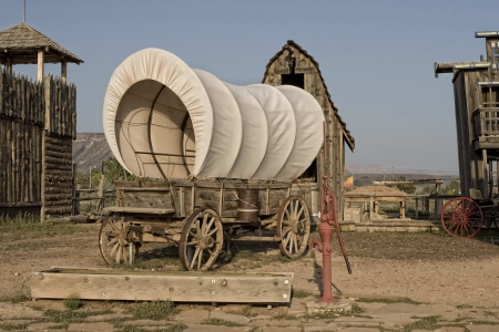 Western covered wagon on yard of Fort