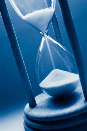 time concept with hourglass in blue tint