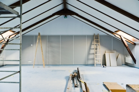 attic renovations with ladder and gray walls