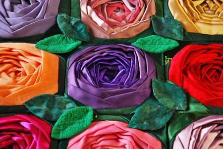 Colorful patchwork quilt with flowers. Handmade work