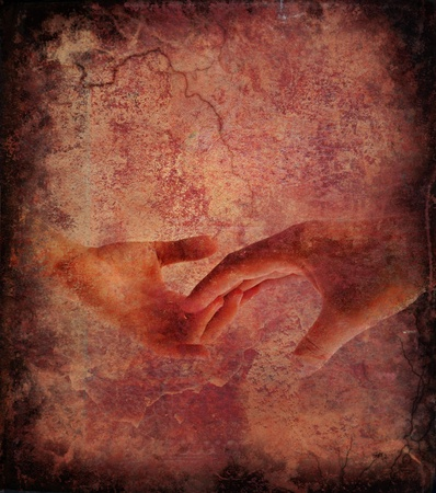 Touching hands over grunge background