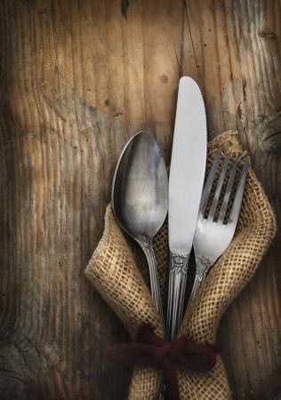 Vintage silverware on rustick wooden backgroundの素材 [FY31014665549]