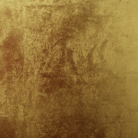 Shiny textured background painted in gold
