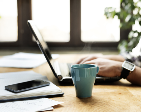 Photo pour Working desk with laptop, notbook and coffe cup. - image libre de droit
