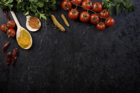 Photo pour Food ingredients and various spices on black rustic background - image libre de droit