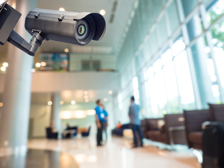 Foto de Security CCTV camera or surveillance system in office building - Imagen libre de derechos