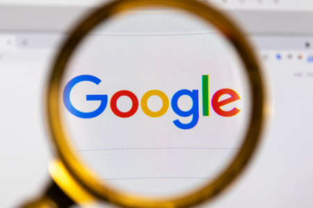 Photo for Moscow, Russia - 31 March 2021: View the Google homepage through a golden magnifier, company logo. High quality photo - Royalty Free Image