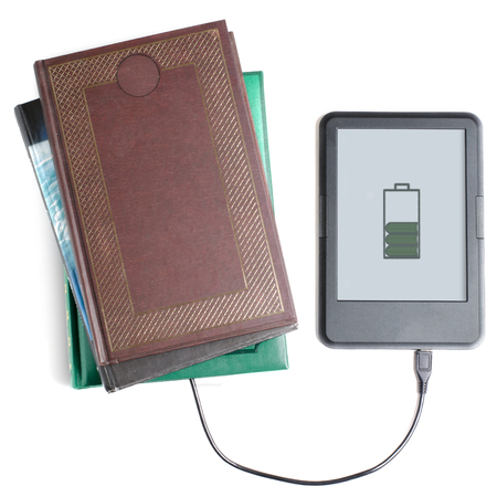 Foto de E-book reader and book connected with cable. White background. Flat top view - Imagen libre de derechos