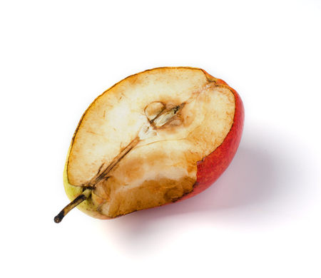 Stale old pear. Bite mark. On white background isolated