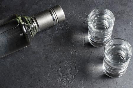 Photo pour A bottle of vodka and two glasses. Copy space - image libre de droit