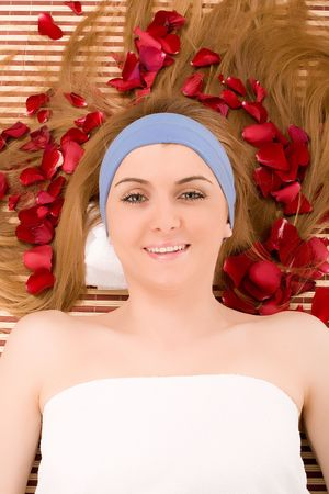 Beautiful girl enjoying in beauty spa.